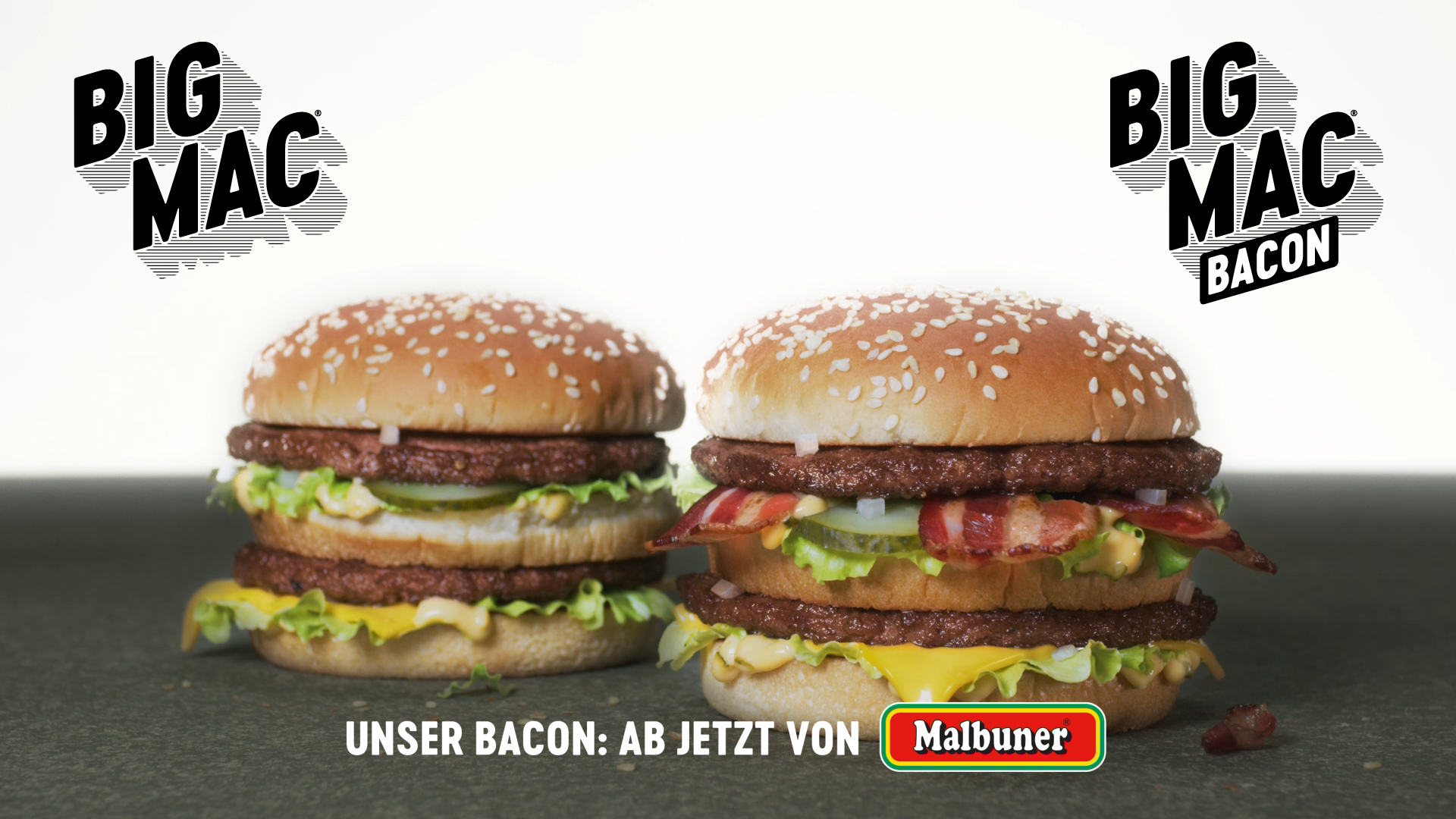 Two McDonald's BigMac Burgers next to each other, one with Malbuner bacon